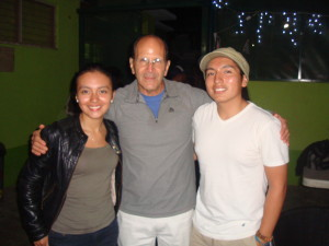 Hermano Juan Mendez (SPR' 10, Beta Beta) poses with wife Mayte Ortiz and shelter founder Padre Solalinde